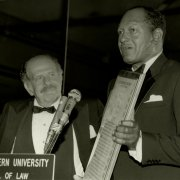 Mayor Bradley presents Lee Rich, co-founder and Chairman of Lorimar Productions, with Southwestern's Distinguished Citizen Award during the 1983 Bradley Scholarship Fund Dinner