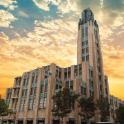 Bullocks Wilshire Building with sunset