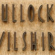 Bullocks Wilshire lettering in bronze
