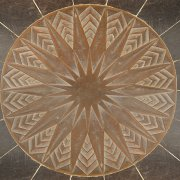 Copper starburst on entryway floor